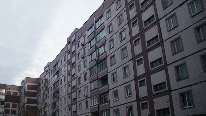 Multistorey Building With Changing Window Lighting At Night. Multi Storey  Houses, In Apartments