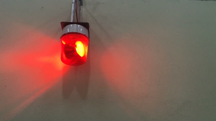 Red Flashing Emergency Signal Siren Light On Concrete Wall