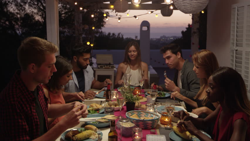 Friends make a toast over dinner on a roof terrace, Ibiza, shot on R3D