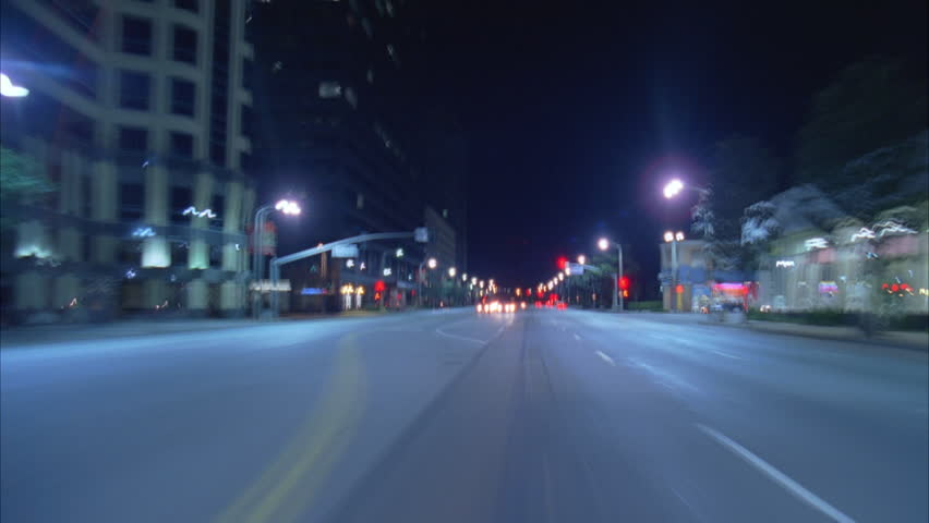Night timelapse Moving POV from car front windshield downtown street, U turn parks end Wilshire Blvd | Shutterstock HD Video #21132715