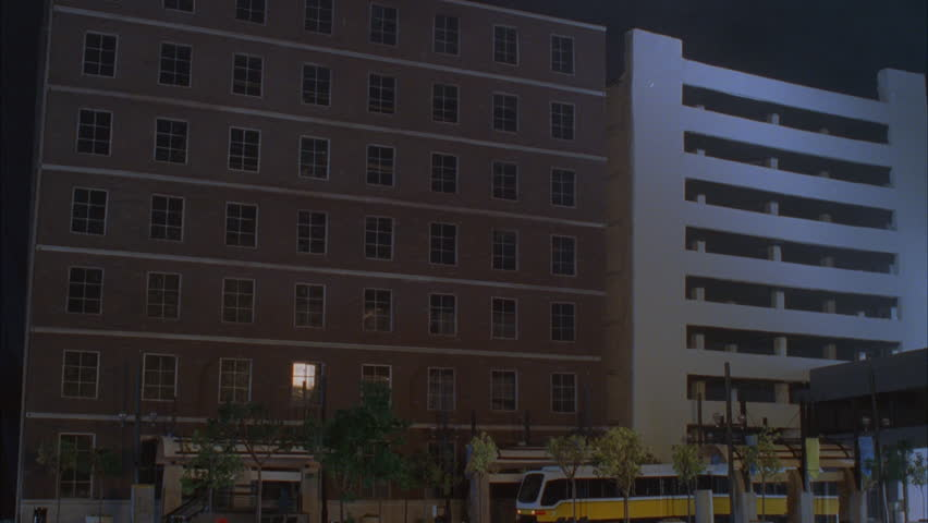 Apartment Inside Night an office building at night with lights on inside. stock footage