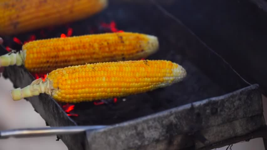 Roast corn chef cooking corn in a jimbaran beach truck with related videos roast corn ccuart Choice Image