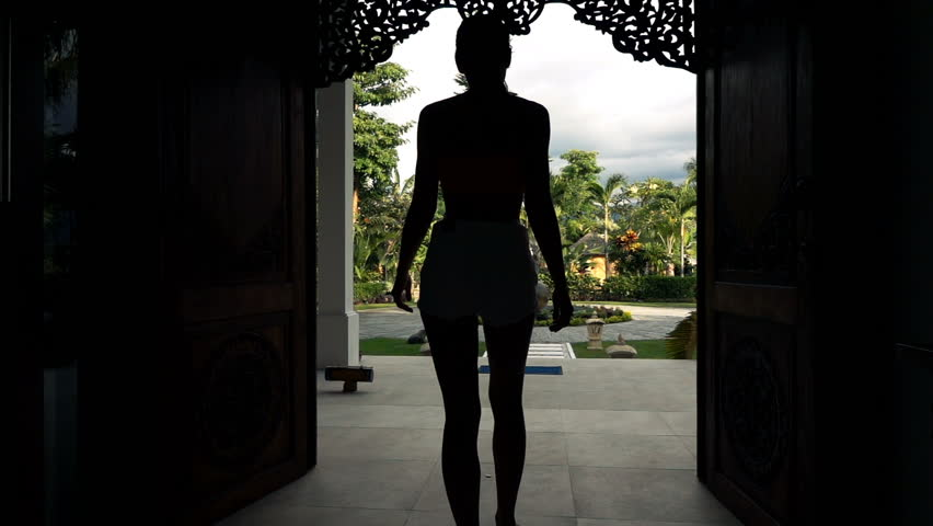 Silhouette Of Man Opening Door And Walking Out On Terrace