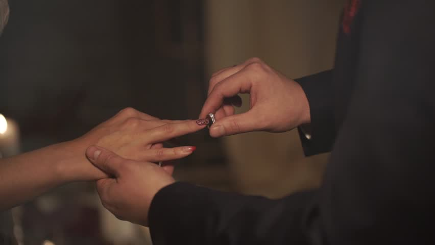 The Groom Wears A Wedding Ring A Bride In A Fabulous Location With