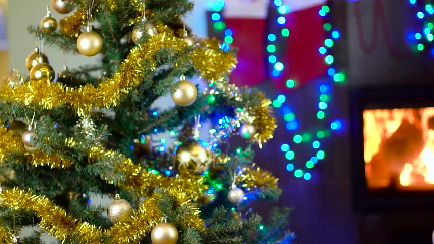 cute boy decorating christmas tree hd stock footage clip - Bubble Light Christmas Tree