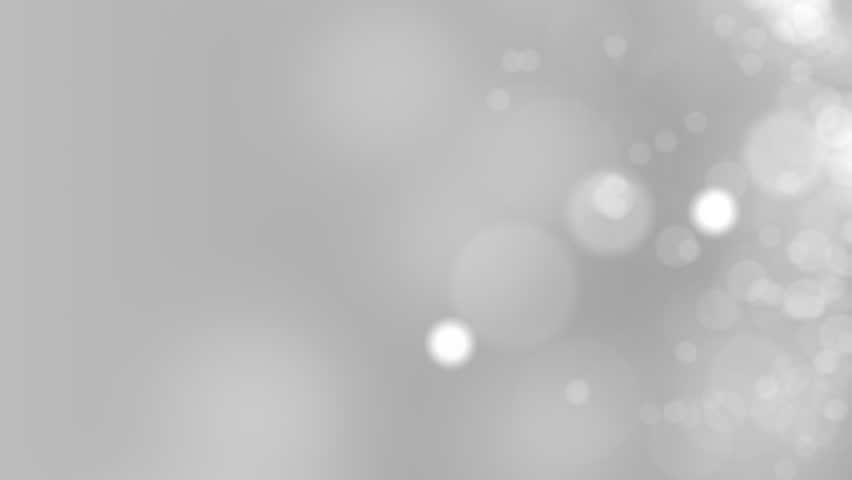 Gray motion background. Abstract glowing bokeh circles or sparks. 4K seamless loop clip | Shutterstock HD Video #21167785