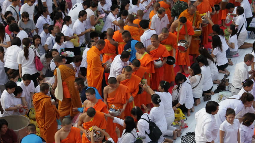 BANGKOK - MARCH 18: Monks are participating in a Mass Alms Giving of 12,600 monks in Central World for the Makha Bucha celebrations on March 18, 2012 in Bangkok, Thailand