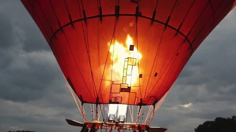 Hot air balloon preparing for take off in the Kenyan savanna.