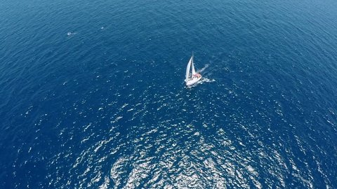 beautiful view of Yacht sailing in open sea. Drone view