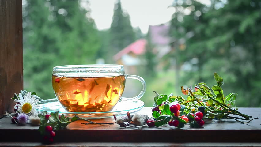 Cup of tea on the window sill. Tea leaves at the bottom of the cup. Tea time. | Shutterstock HD Video #21254695