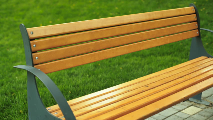Video Bench Part - 28: Young Lady Sitting On A Bench After Long Running Distance And Listening To  Music On Her
