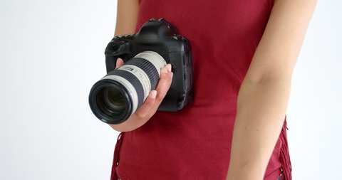Photographer Showing Visiting Card While Taking Photo With Digital Camera In Studio 4k