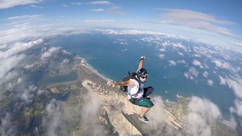 Skydiver jump above the coast