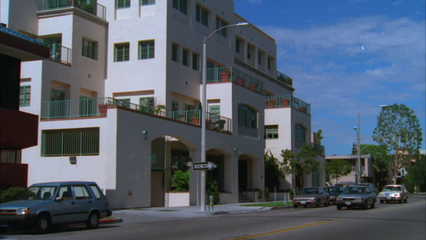 day pan left up 5 story multi level sante fe stucco style office apartment building - Beach Style Apartment 2015