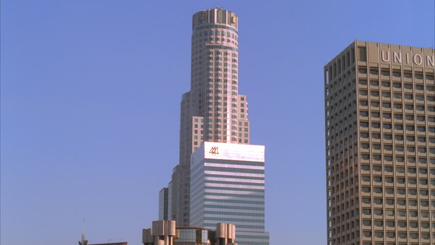 Day High Angle Pan Right Down Over Tall Office Buildings Skyline   HD Stock  Video Clip
