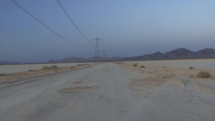 Zoom in on isolated road in desert  | Shutterstock HD Video #2133035