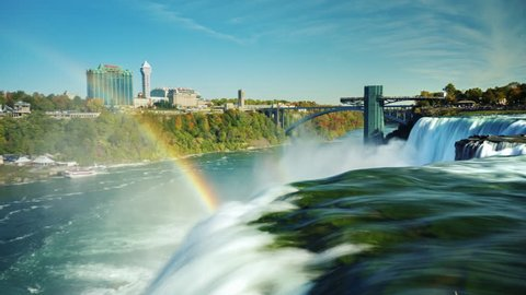 The world-famous Niagara Falls - a popular place among tourists. In the picture, one can see two waterfalls and the Canadian shore of the Niagara River. Beautiful rainbow over the waterfall