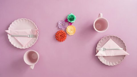 Setting the table in light pink with paper flowers