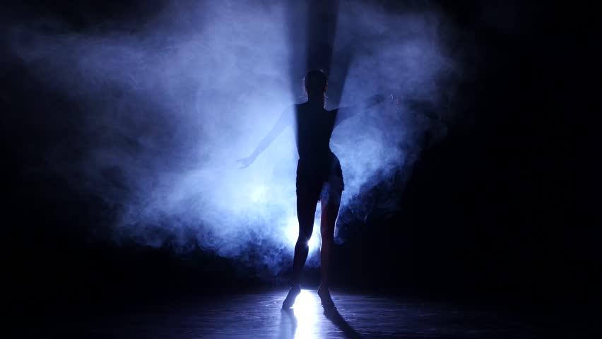 Woman dancing cha-cha-cha in studio, silhouette. Dark background, blue backlight