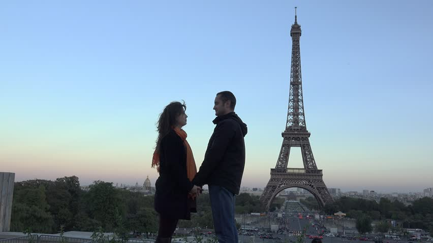 Couple of lovers silhouette holding theirs hands, Eiffel tower, evening colored sky | Shutterstock HD Video #21396895