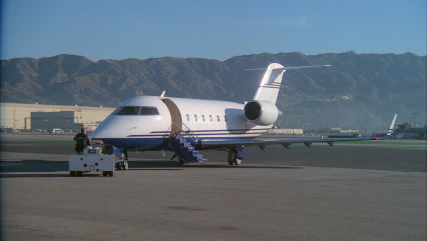 day Private jet door open stairs down being pushed backwards small vehicle tarmac ND airport - : jet doors - Pezcame.Com