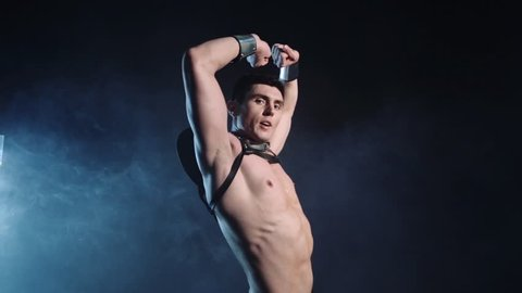 Sexy muscular man dance on dark background. Beautiful body. Sex and passion. Copy space text. Professional color correction.