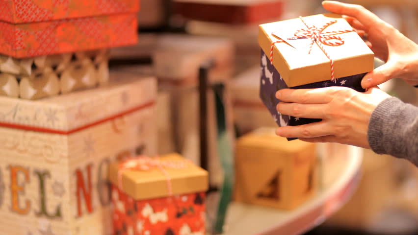 Young woman in shop chooses a gift for the New Year and Christmas.