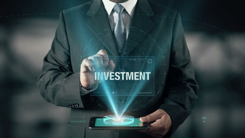 Businessman with Investment concept choose Real Estate from Atiques Metals Bonds Stocks Mutual Funds using digital tablet | Shutterstock HD Video #21477355