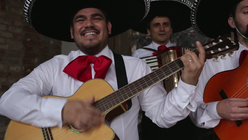 Mexican musicians in the studio, in the interior. Happy people. Men are smiling.