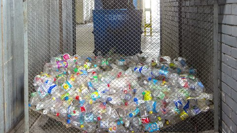 Plastic is sorted by color. Waste sorting.  4k+. Time lapse
