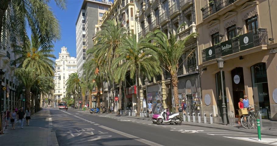 VALENCIA, SPAIN - JULY 21, 2016: People Walking Downtown Valencia City In Spain.