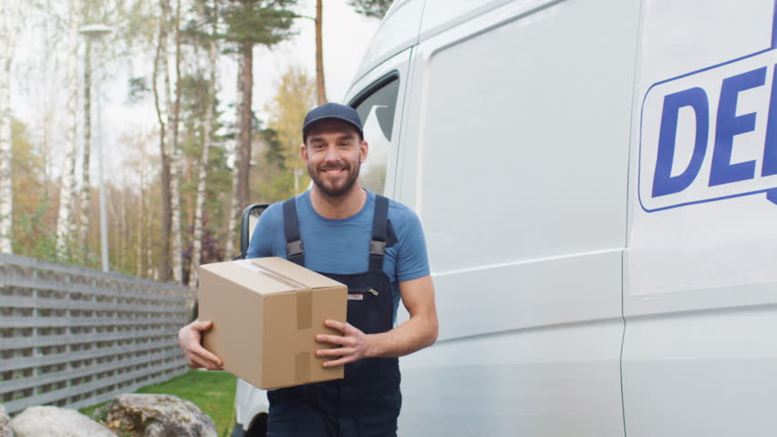 Smiling Delivery Man Comes Out of His Cargo Van with Cardboard Boxes and Goes Towards Camera. Shot on RED Cinema Camera in 4K (UHD). | Shutterstock HD Video #21531475