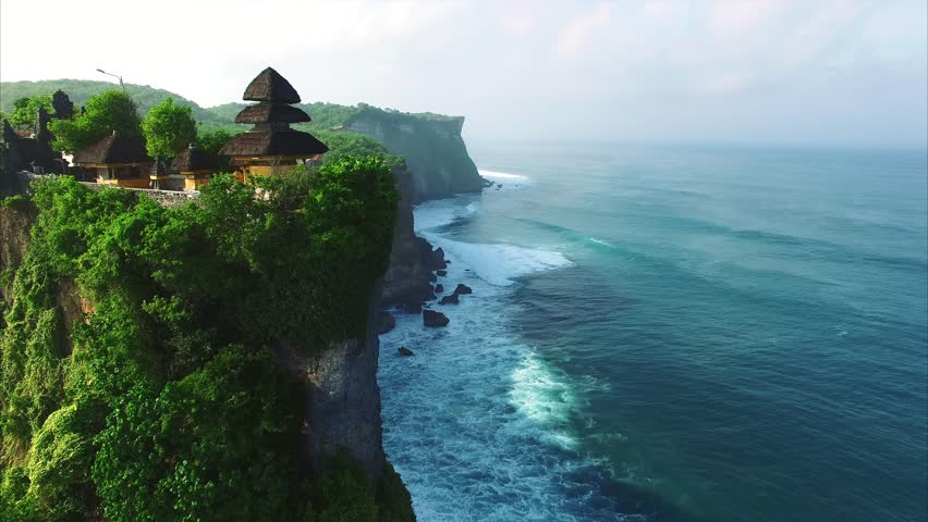 pura uluwatu temple  stone cliffs  ocean waves and
