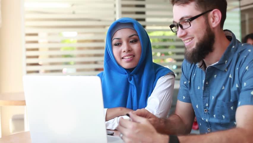 International multicultural team at work: asian muslim woman and caucasian man | Shutterstock HD Video #21559654