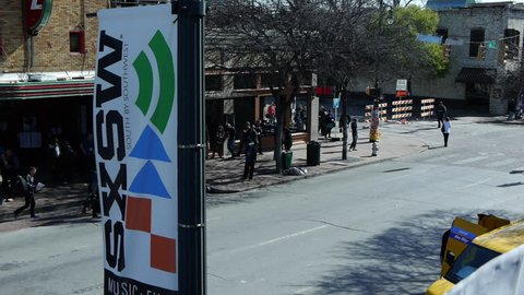 AUSTIN, TEXAS CIRCA 2014 -Timelapse of  6th street in the morning during SXSW with people walking, a band crossing the street, moving trucks and other cars during SXSW music festival