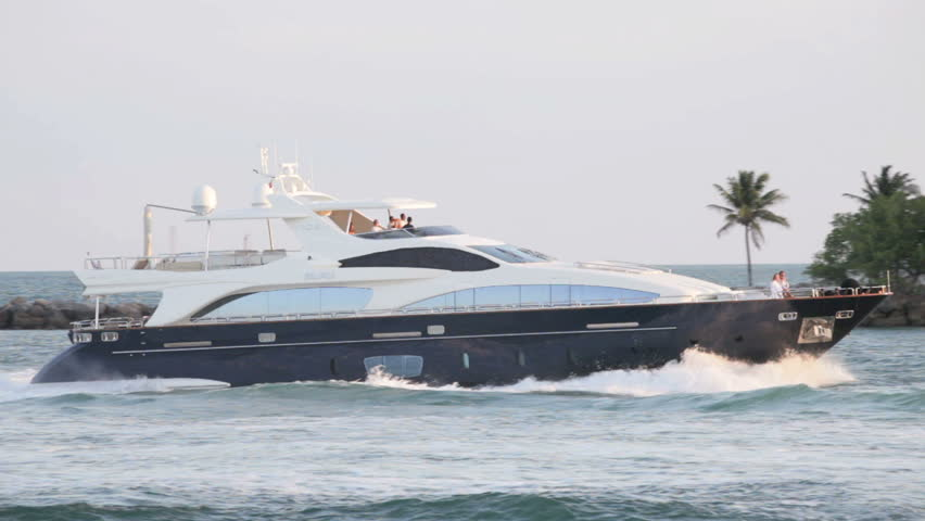 MIAMI - APRIL 12: Luxury yacht passing through Government Cut Inlet in Miami Beach on April 12, 2012 in Miami, Florida