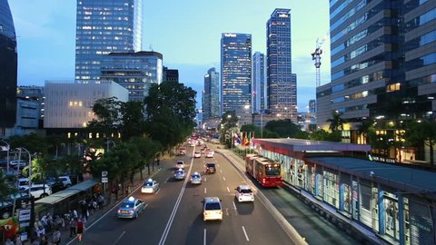 Traffic rush through the main street in Jakarta business district, Jalan Thamrin, in Indonesia capital city at night. Jakarta is South East Asia largest city.