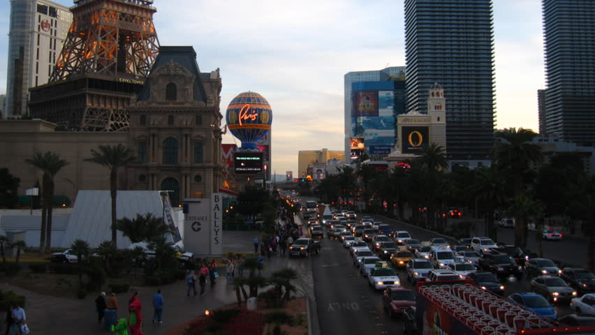 LAS VEGAS - CIRCA FEBRUARY 2012: (Timelapse View) Sunset shot looking south down Las Vegas Blvd. from a pedestrian bridge. Casinos visible including the Bellagio, Ballys, Paris and Planet Hollywood. | Shutterstock HD Video #2166500