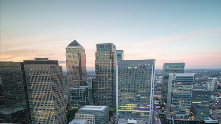 beautiful sunset timelapse of the financial skyscrapers of london docklands, canary wharf shot from a unique high vantage point