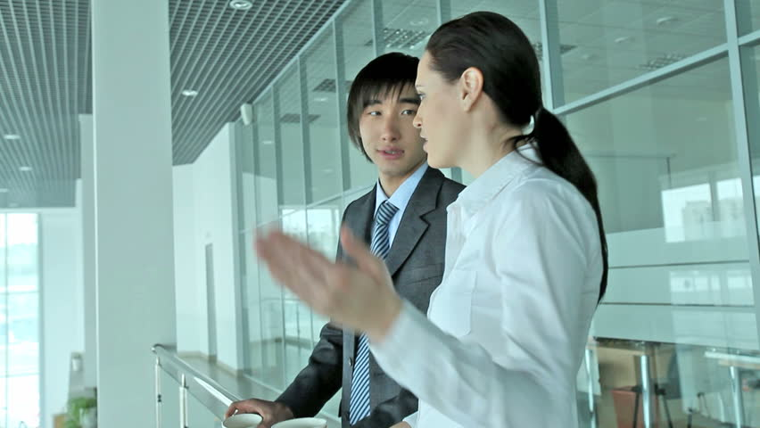 Business people having a small talk in the middle of the working day | Shutterstock HD Video #2167595