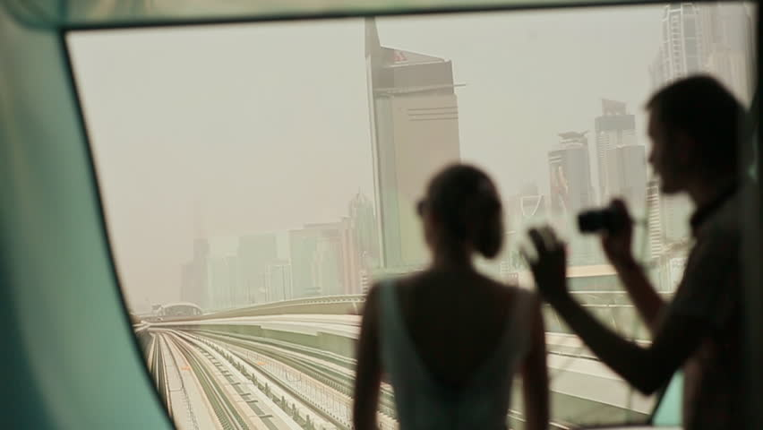 Love couple ride on a train Dubai Metro and photographed | Shutterstock HD Video #21698965