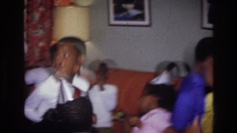 HARLEM NEW YORK 1976: party of kids dancing around the room and having a blast listening to their favorite music