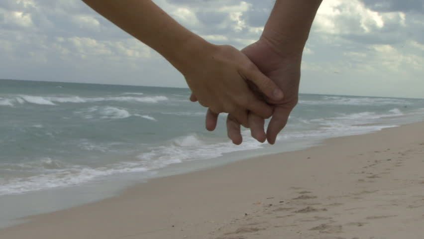 Couple Holding Hands Walking Along Stock Footage Video