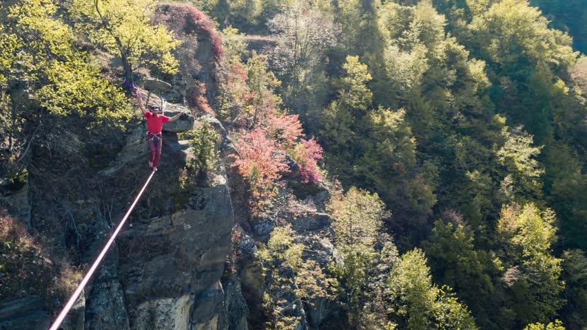 Brave Man Slacklining Above Autumn Trees Season Nature Danger Adventure Leisure Sport Mountain Balance Extreme Hiker Walking Happy