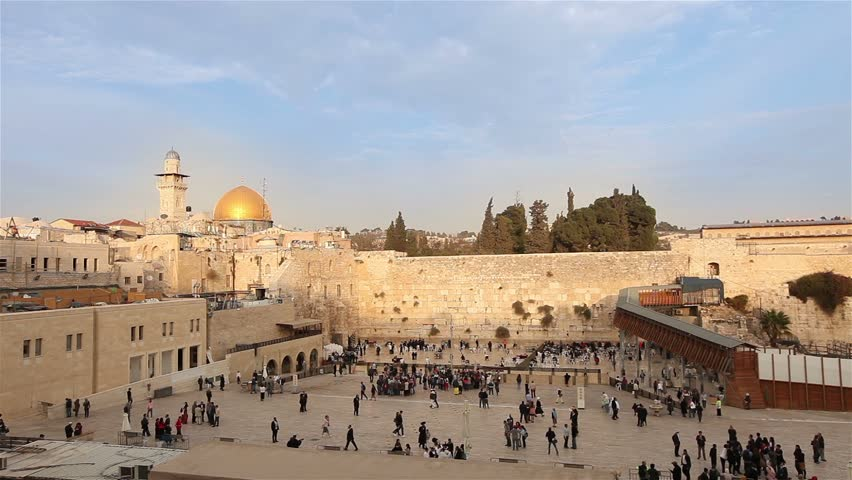 Jerusalem, Western Wall and Dome of the Rock, Sunny day,  blue sky, clouds, people in the area, Israel flag, general plan, Timelapse, top shooting, zoom