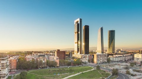 madrid skyline cityscape timelapse from day to night aerial view of skyscrapers business area