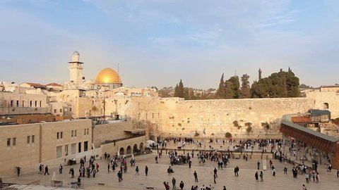 Israel, Jerusalem western wall. The Western Wall,  Wailing Wall, Jewish shrine, old city of Jerusalem, Orthodox Jews pray, religion, Timelapse, zoom, panorama