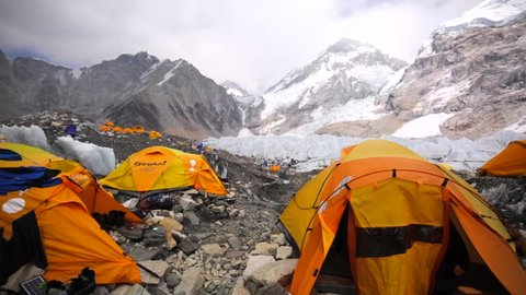 EVEREST BASE CAMP, NEPAL - APRIL 30, 2016: View of tents established on Khumbu Icefall for tourists' convenience, Everest base camp. Picturesque mountains are on the background. Himalaya, Nepal