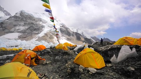 EVEREST BASE CAMP, NEPAL - APRIL 30, 2016: Panoramic view of Everest base camp, tent village established on Khumbu Icefall. Everest, Nuptse, Lhotse mountains are on the background