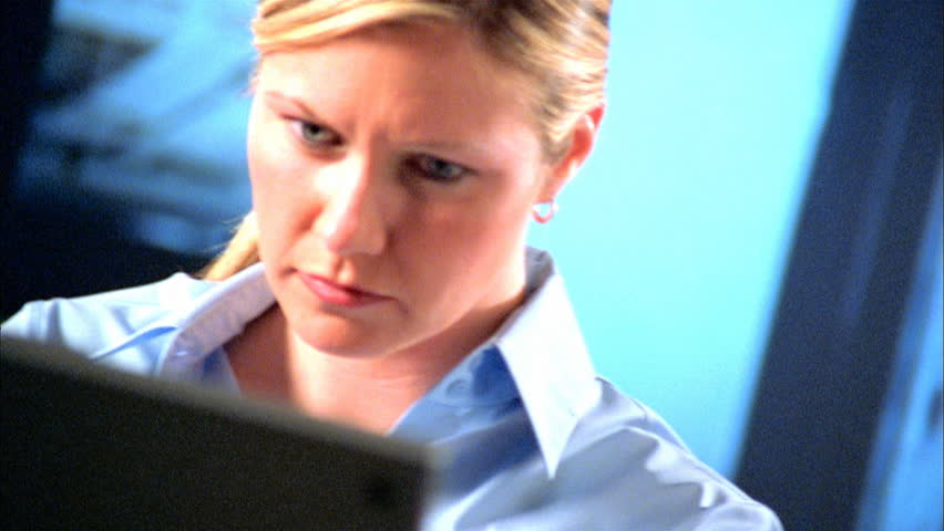 Quizzical business woman at computer
